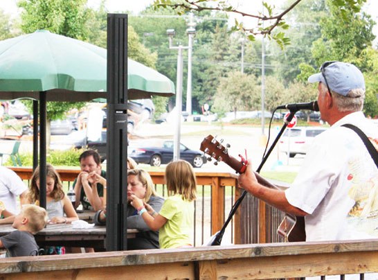 singer outdoors at Dutch Village in Holland, Michigan