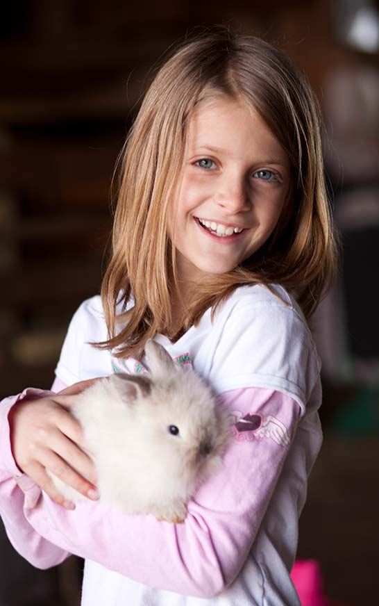 Dutch Village Petting Farm Girl with Rabbit
